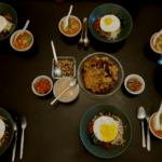 Homemade Korean bibimbap, kimchi soup and patron seafood pancake